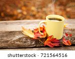tea mug on wooden surface with... | Shutterstock . vector #721564516