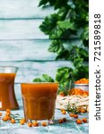 thick orange drink in the glass ... | Shutterstock . vector #721589818