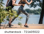 partial view of sportive couple ... | Shutterstock . vector #721605022