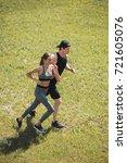 young couple in sportswear... | Shutterstock . vector #721605076