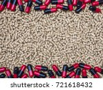 pill capsules on pelleted feed... | Shutterstock . vector #721618432