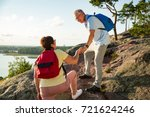 active senior couple hiking on... | Shutterstock . vector #721624246