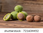 fresh harvest of walnuts on a... | Shutterstock . vector #721634452