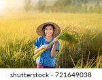 Asian Peasant Girl Holding Ric...