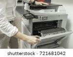 man checking paper jam from... | Shutterstock . vector #721681042