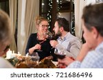 young couple celebrating... | Shutterstock . vector #721686496