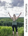 woman arms raised up to sky    Shutterstock . vector #721694416