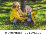 two happy brothers in yellow... | Shutterstock . vector #721696132