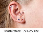 ear piercing | Shutterstock . vector #721697122