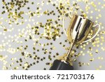 gold winners trophy with golden ... | Shutterstock . vector #721703176