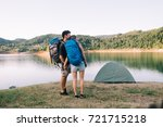 hiking couple. young couple... | Shutterstock . vector #721715218
