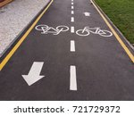 white bicycle sign with arrow... | Shutterstock . vector #721729372