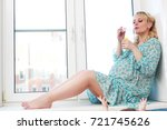 beautiful girl pregnant blonde... | Shutterstock . vector #721745626