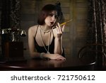 beautiful 1930s girl smokes a... | Shutterstock . vector #721750612