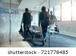 business people walking in... | Shutterstock . vector #721778485