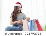 beautiful woman wearing a santa ... | Shutterstock . vector #721793716