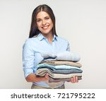 smiling woman holding stack of... | Shutterstock . vector #721795222