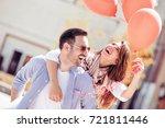 romantic couple having fun... | Shutterstock . vector #721811446