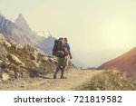hiker with backpacks reaches... | Shutterstock . vector #721819582