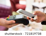 female paying with nfc... | Shutterstock . vector #721819738