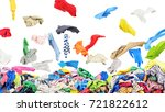 Stock photo separate clothing falling at the big pile of clothes on a white background 721822612