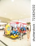 Small photo of Blurred image kids enjoy riding electric toy cars in shopping mall, Houston, Texas, USA. Indoor game colorful electric powered sit on rides for infants, toddlers amusement park alike. Parent and child