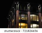 office building at night ... | Shutterstock . vector #721826656