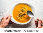 pumpkin soup with seeds and a...