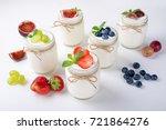 fresh yogurt with berries in... | Shutterstock . vector #721864276