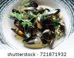 steamed mussels | Shutterstock . vector #721871932