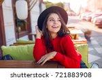 enthusiastic woman in trendy... | Shutterstock . vector #721883908