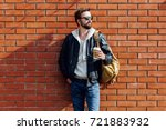 fashionable handsome man with... | Shutterstock . vector #721883932