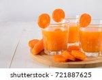 fresh carrot juice on a wooden... | Shutterstock . vector #721887625