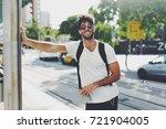 attractive young man wearing...   Shutterstock . vector #721904005