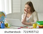 teen girl using laptop | Shutterstock . vector #721905712