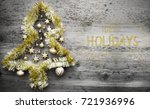 golden tinsel christmas tree ... | Shutterstock . vector #721936996