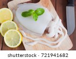 fresh squid placed on a cutting ... | Shutterstock . vector #721941682