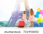 two girls holding hands while... | Shutterstock . vector #721953052
