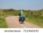 Cyclist On A Bike Path In The...
