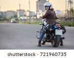 woman a motorcyclist looking...   Shutterstock . vector #721960735