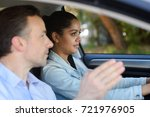 young woman learning to drive | Shutterstock . vector #721976905