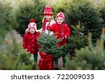 family selecting christmas tree.... | Shutterstock . vector #722009035