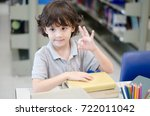 cute little boy is studying at... | Shutterstock . vector #722011042