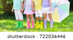 kids in rain boots. group of... | Shutterstock . vector #722036446