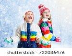 kids playing in snow. children... | Shutterstock . vector #722036476