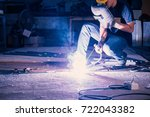 worker while doing a welding... | Shutterstock . vector #722043382