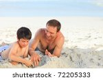 father with his son on the beach | Shutterstock . vector #72205333