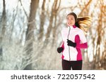 winter run woman runner... | Shutterstock . vector #722057542