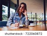 portrait of attractive student... | Shutterstock . vector #722060872