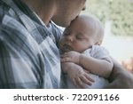 father holding newborn baby son ... | Shutterstock . vector #722091166